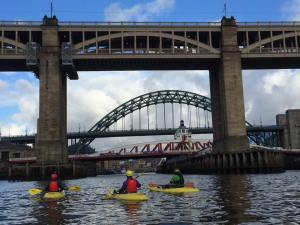 Kayakers approach the High Level Bridge on the Tyne