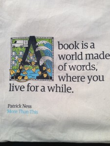 "Picture of a quote ""A book is a world made of words, where you live for a while."""