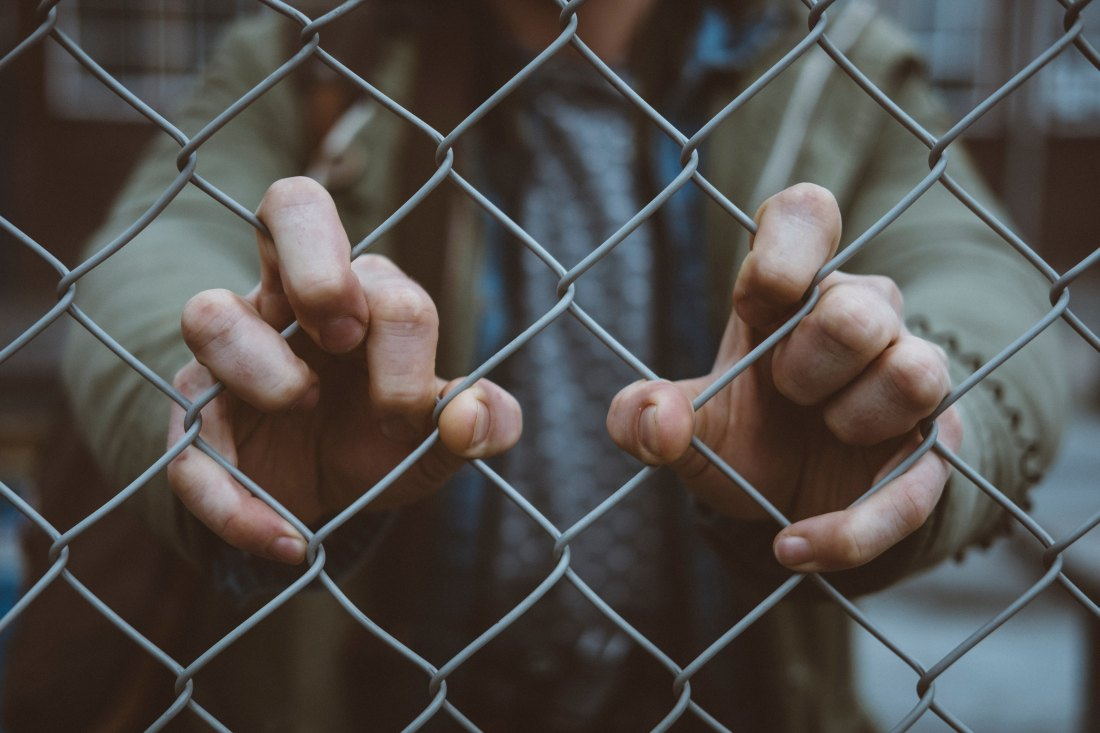 hands on fence