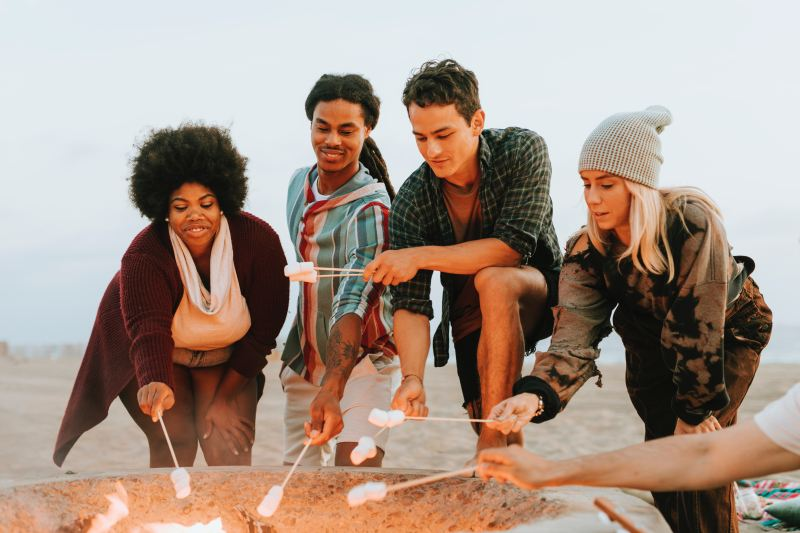 fill your life, happy group roasting marshmallows