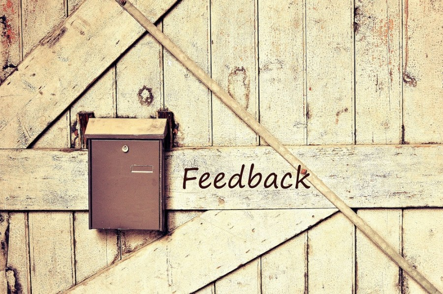Feedback sign beside postbox