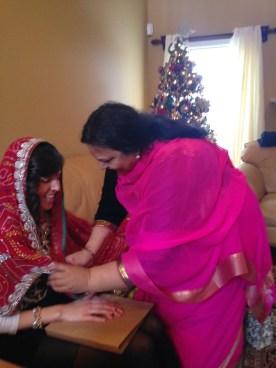 Rahul's mom gifting me the lehenga.