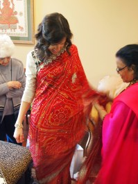Rahul's aunt wrapping the lehenga, which she made.