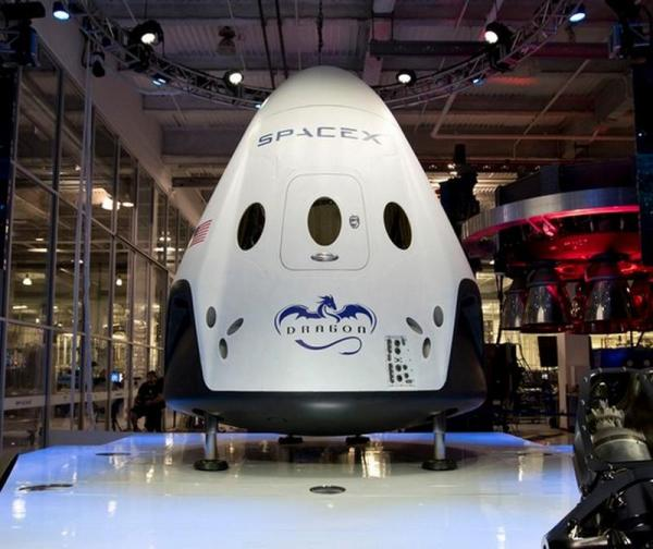 Elon Musk unveils Dragon V2 Space Taxi for Astronauts ...