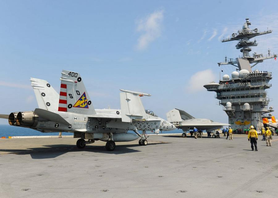 X 47b Drone Share The Deck With F A 18 Aircraft