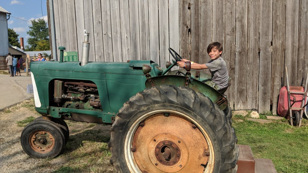 Diego. On a Tractor