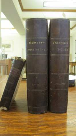 Webster's An American Dictionary (on right) with his Philosophical and Practical grammar (left).
