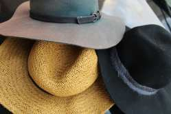 Felisa Iglesias's favorite three hats wait to be worn on Saturday, Sept. 26, 2020 in Hollywood, Fla. A fashion enthusiast, Iglesias has a collection of many hats, heels and dresses. (J24/Leidy Iglesias)