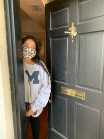 Saida Zerouali peeks out her door on Monday, Sept. 21, 2020. Zerouali has an exam today and needed to study. (J24/Isabella Cammisa)