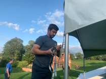Rob Staudigel begins to disassemble a tent at the Vanderbilt Museum in Northport, N.Y., Friday, Sept. 18, 2020. Accompanied by his father, Glenn Staudigel (left), they are taking down a tent used for a wedding party the day prior. (JOUR 024/Samantha Gentile)