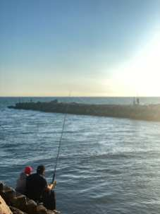 Two Weekapaug residents fishing off the jette at Fenway Beach Friday October 2, 2020, in Weekapaug, R.I. Fishing is one of the only activities that was not restricted this summer (Bonfiglio, J24)
