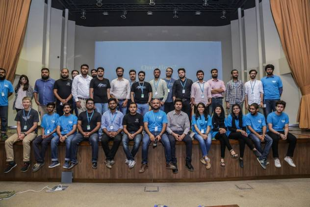 Abdullah Ramzan among a group of community members at WordCamp Karachi 2018