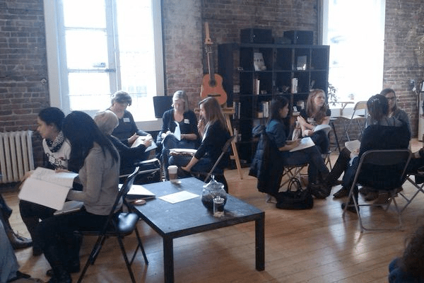 women gathering to discussion presentation topics