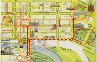 目的地を丸で囲み,矢印で道順を示した街の地図