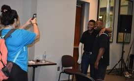 PROMISE youth and staff members line up for nearly an hour to say hello and take pictures with speaker Inky Johnson on Thursday.