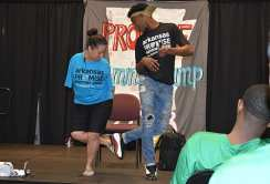 """Jessica Cox and a PROMISE youth participant do the """"foot five,"""" which Cox said was her version of a handshake."""