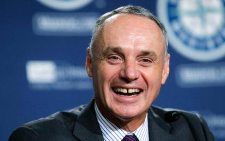 Rob Manfred laughing at how much he hates baseball.