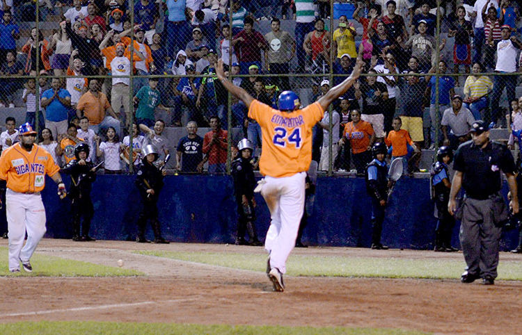 A player from Gigantes de Rivas celebrates scoring a run.