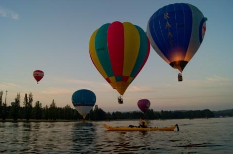 Paddling below balloons