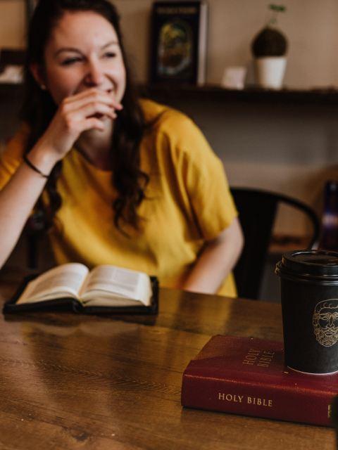 woman bible laughing