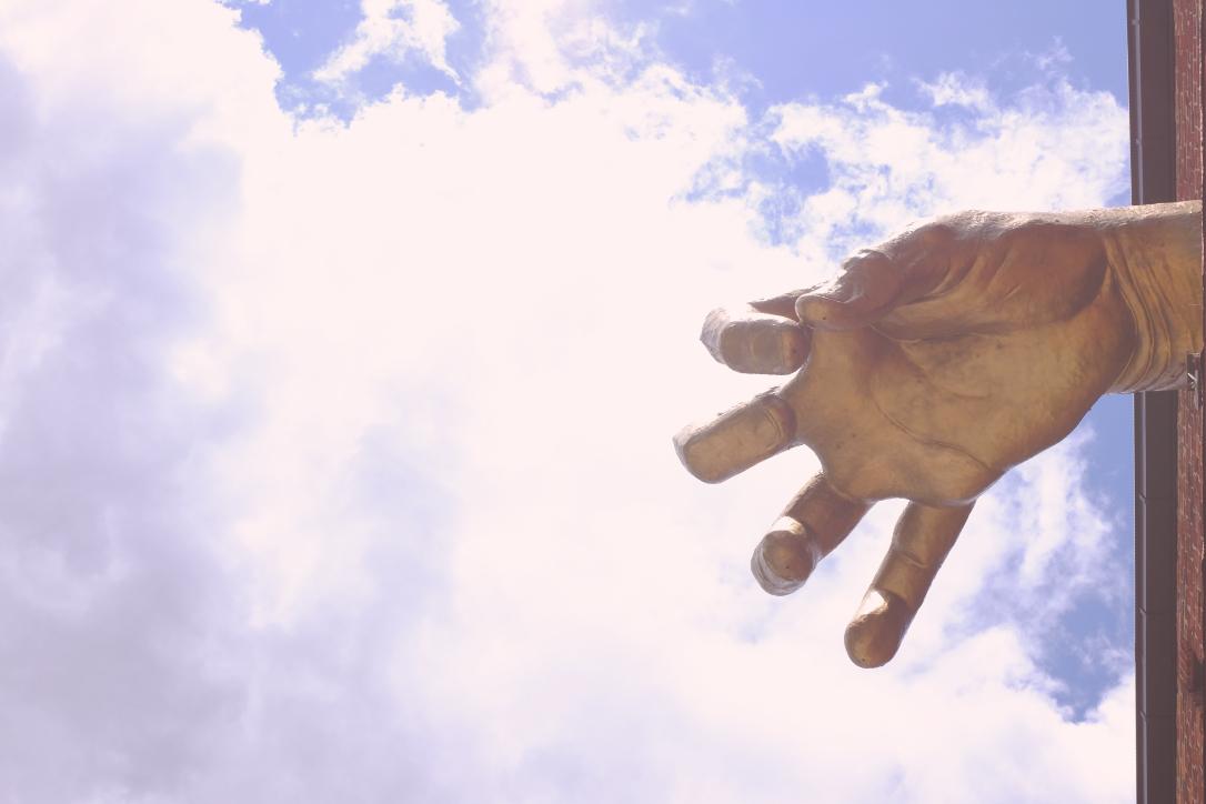Giant Golden Hand sculpture by Adam Kurtzman