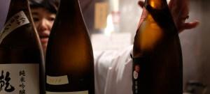 Sake bottles in a Tokyo bar.