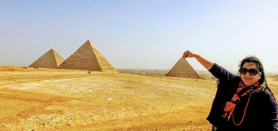 Holding the peak of Menkaure's pyramid