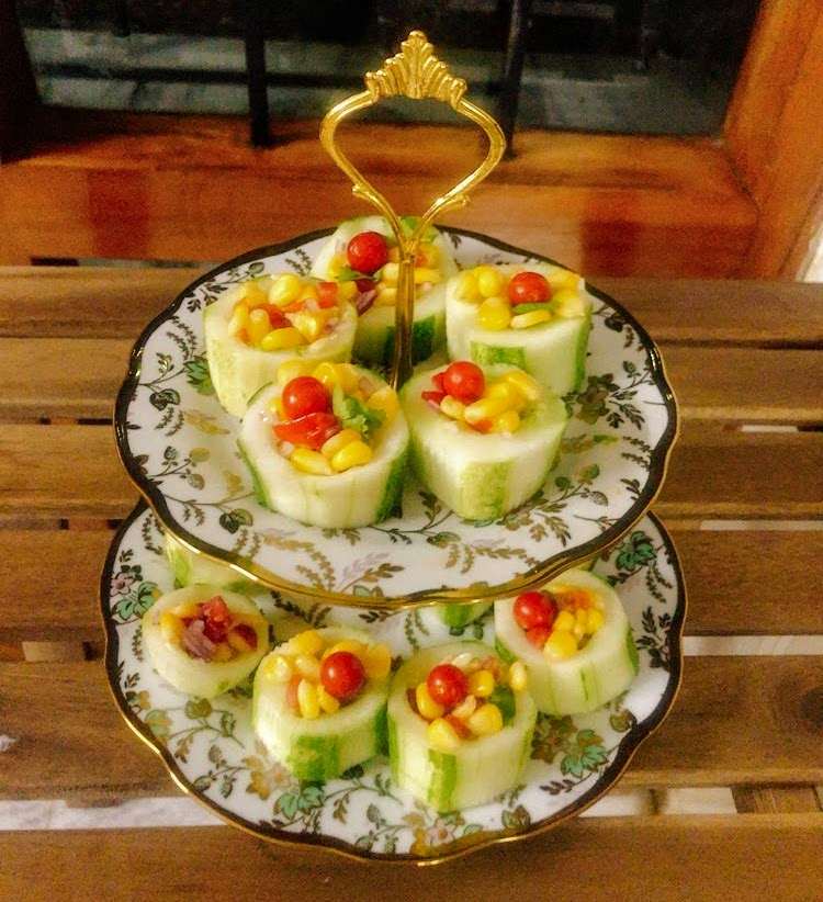 delectable corn salad in cucumber boats