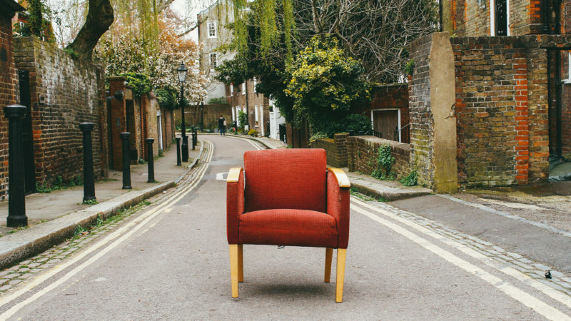 Red chair in the middle of the side road