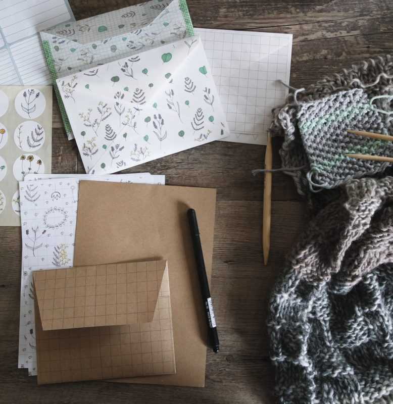 Flay lay of stationary, scarf, pen