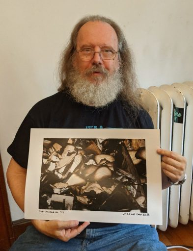 """Me holding 13x19 print of """"The Princess Bride in the Rubble"""""""