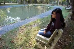 Sitting-outside-park-33150-l