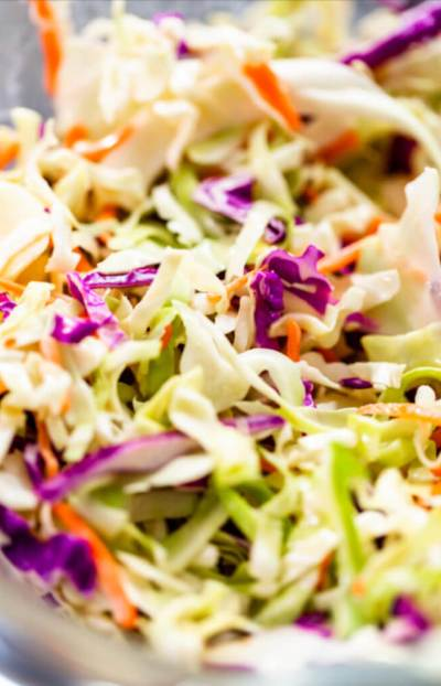 Memphis Style Keto Coleslaw [Low Carb, Sugar-Free] Pulled pork's favorite low carb sidekick & summer salad! Creamy, classic low carb coleslaw recipe with Southern flavor & 3.2 net carbs! Try this homemade, sugar-free Memphis style coleslaw at your next BBQ or cookout! A delicious keto-friendly version of the traditional creamy coleslaw recipe! The must-have keto side dish for your low carb grill recipes this summer! #keto #lowcarb