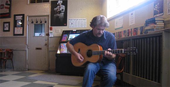 Denis Turbide, playing a Larrivée 00-50