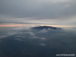 A glimpse of Hawaii's tallest volcano peeking out above the clouds.