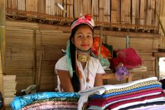 From the age of five or six, Padaung girls begin winding a series of heavy brass coils around their necks to give them an elongated appearance. The coils, weighing up to four or five kilograms by the time a woman reaches adulthood, push down on their collarbones and compress their ribcages, resulting in a cultural garb unique to the Padaung.