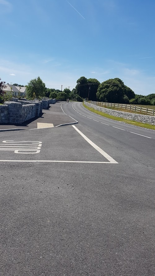 straight ahead for coole park, bridge behind you