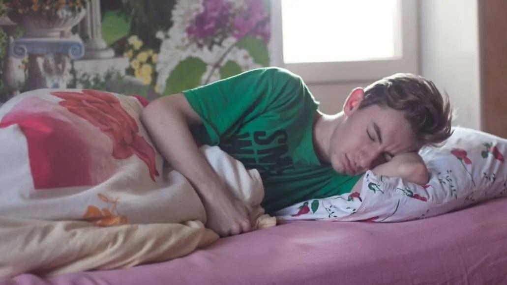 A teen boy sleeping