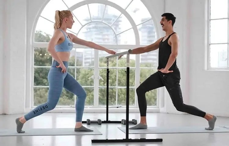 working out with a ballet barre
