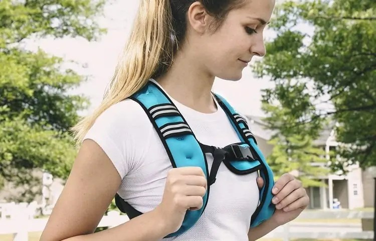 fit girl with weighted vest