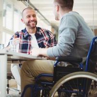 two people talking to illustrate the growing number of disabled people in self-employment