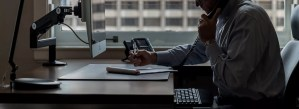 Jeffrey Sloan working on computer