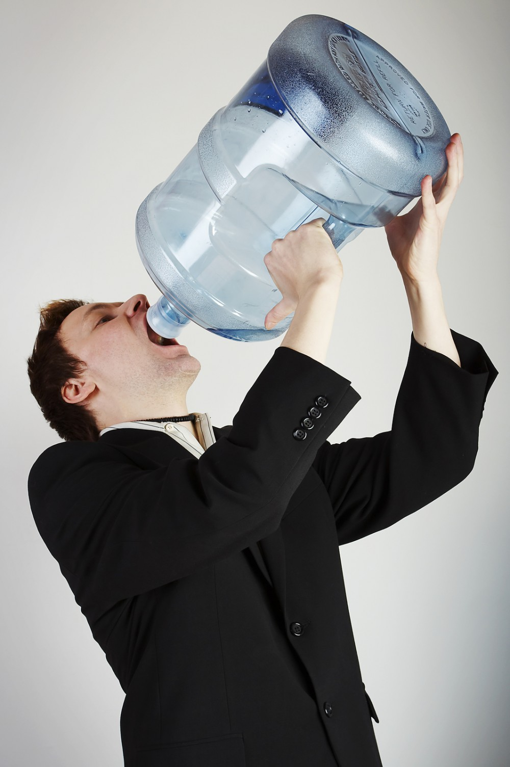 bigstock-Man-With-Huge-Water-Bottle-1999993-1000x1505