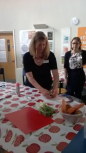 community food training company demonstrating basic food preparation skills for Healthy Eating with Community youth workers