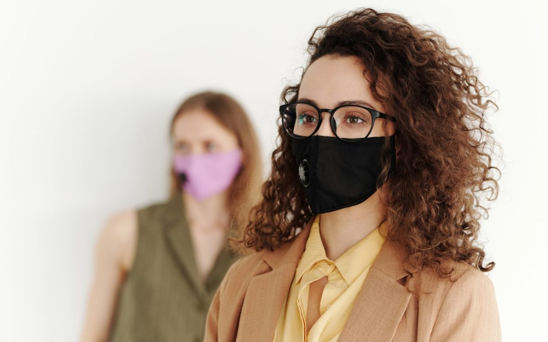 Woman wearing a face mask when she returns to work