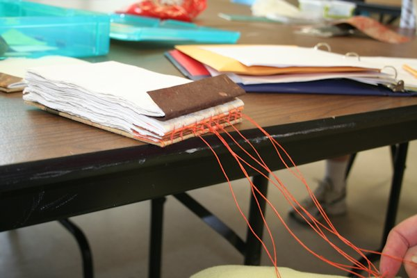 Sewing a coptic journal in workshop by Susi Hall