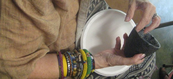 Suzanne Hall casting a handmade paper bowl