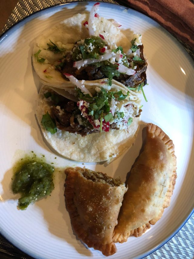 Curbside Pickup from Torre:  two Monterrey beef tacos, one-and-a-half beef empanadas, and salsa verde.