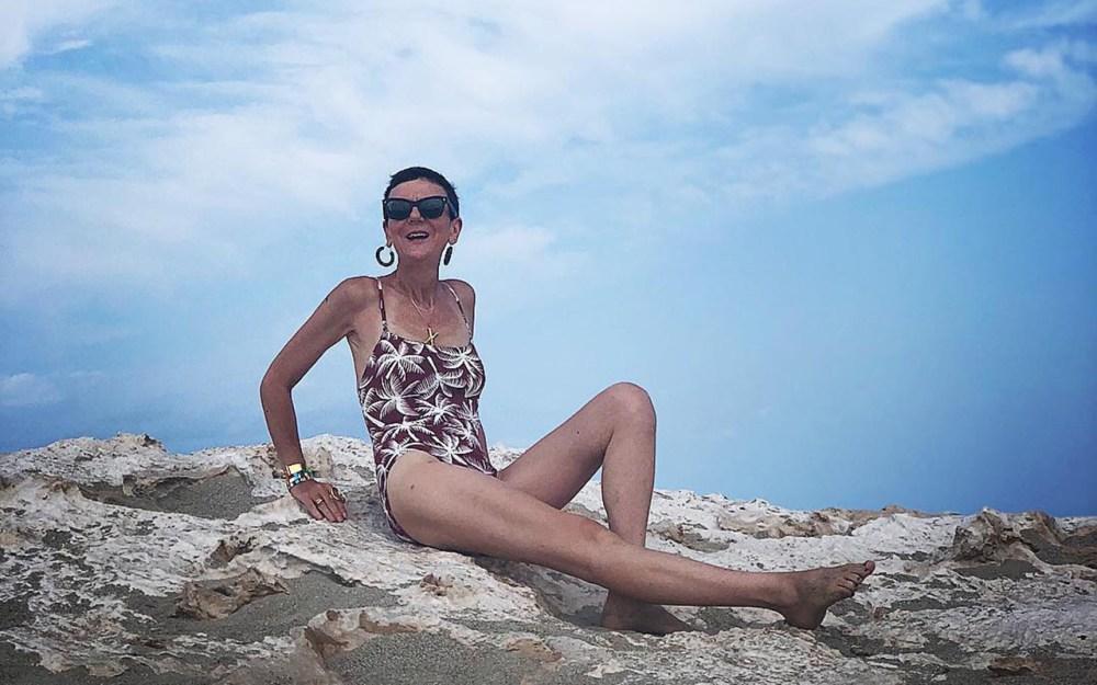 Frederique Gilain wearing Eres swimsuit and Celine earrings