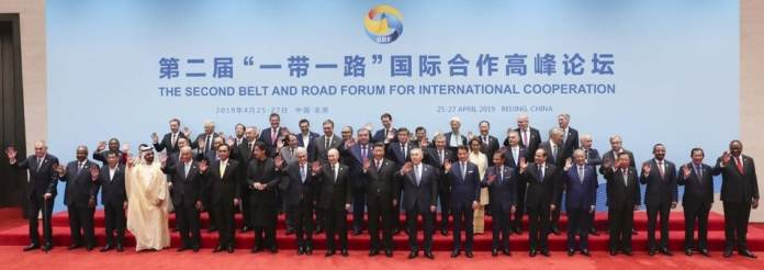 President Xi Jinping and foreign dignitaries pose for a photo following the leaders\' roundtable